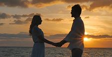 Romance couple enjoys a beautiful seascape and