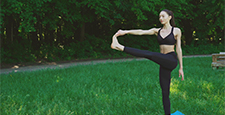 Young beautiful woman practicing outdoors, doing