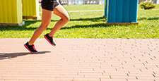 legs of girl running in a sports competition