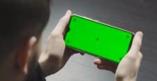 Man looking at screen of mobile phone